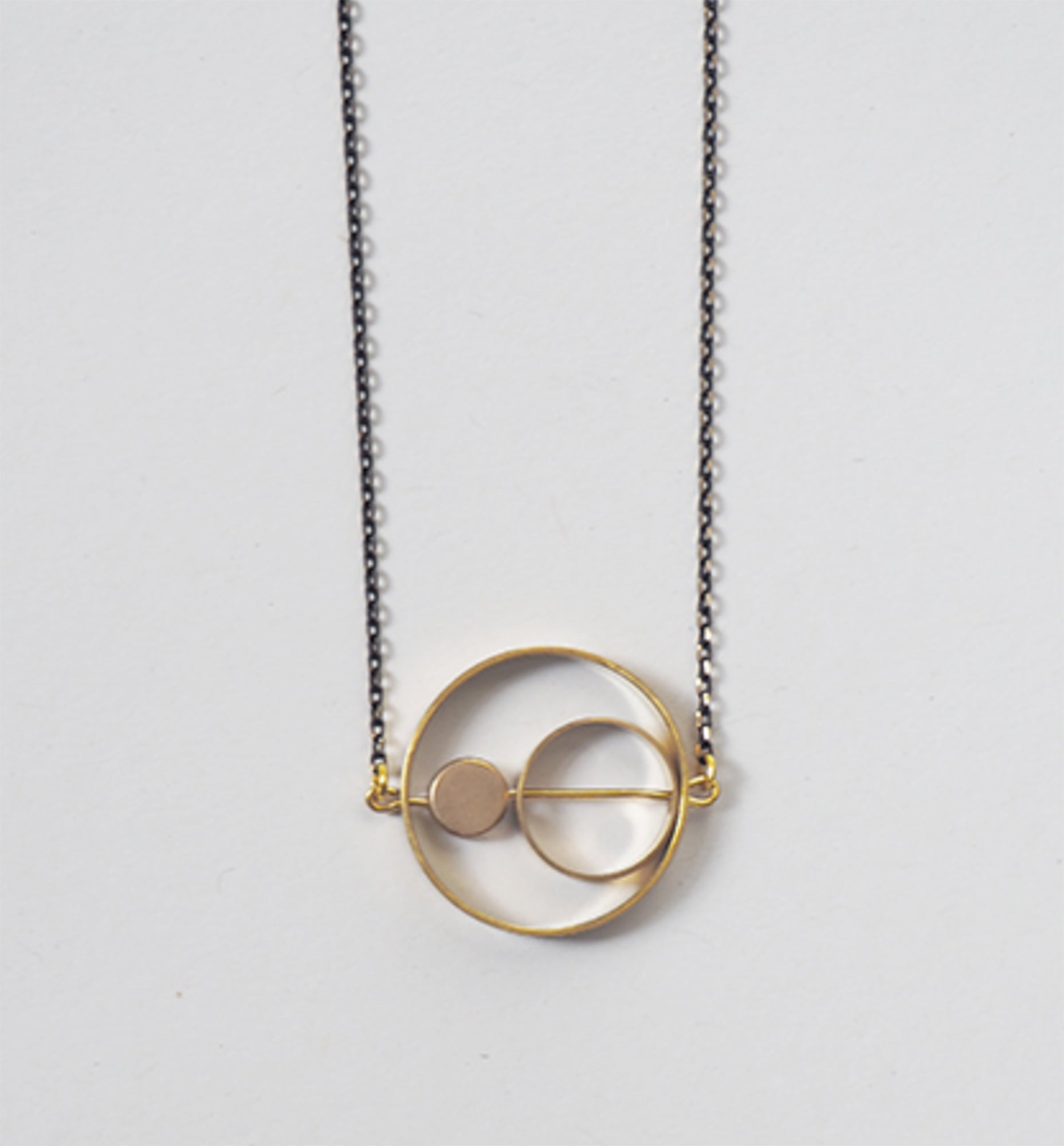 Brass rings within rings necklace