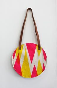 Small pink and yellow triangle design circular bag - Inspired