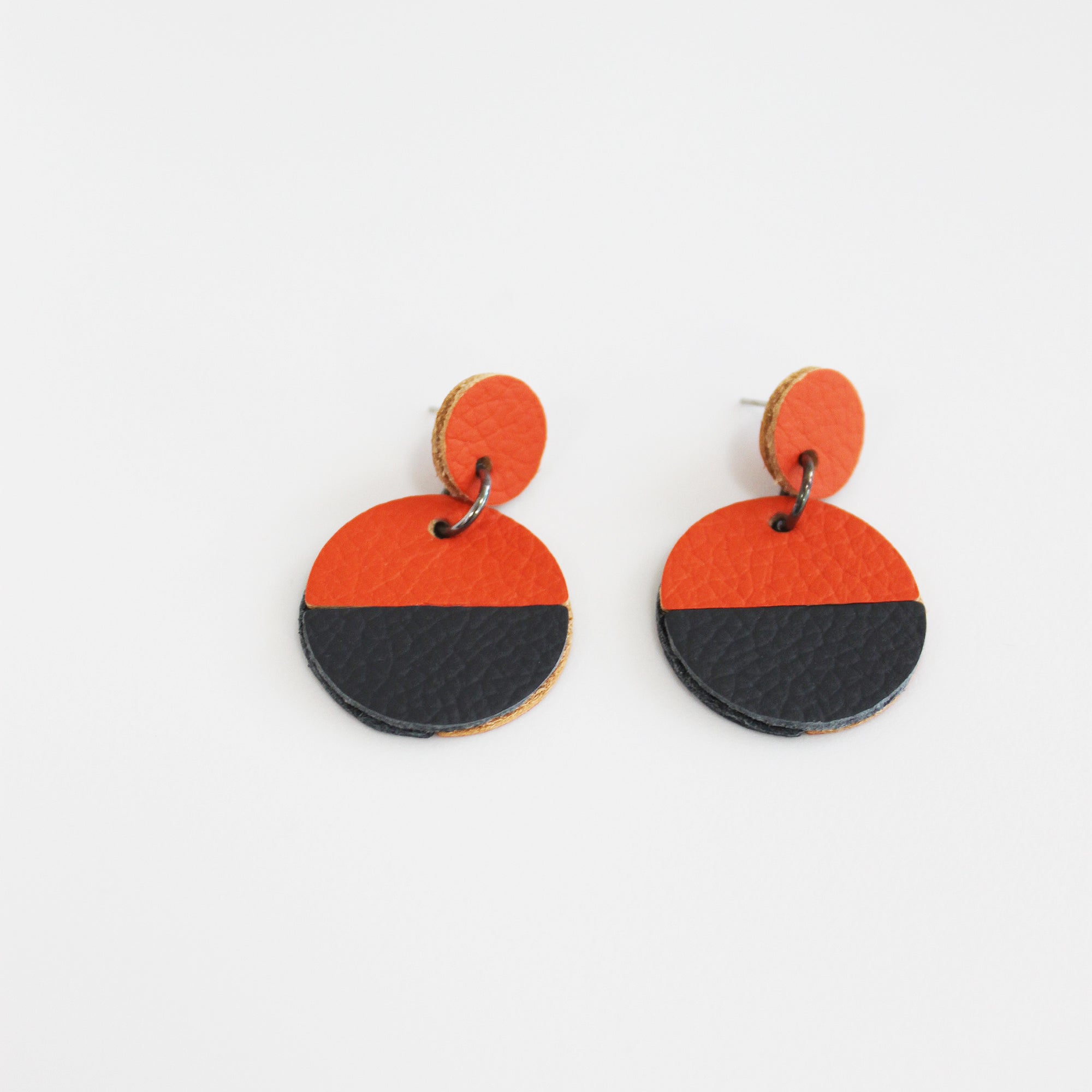 Orange and grey circular leather dangle earrings - Inspired