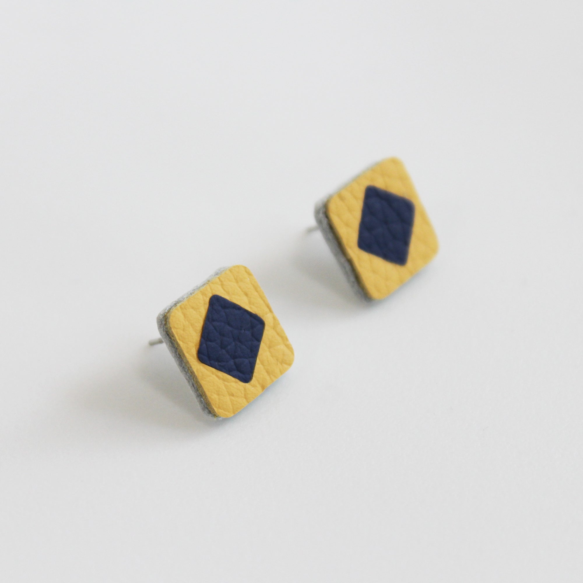 Yellow and navy leather stud earring - Inspired
