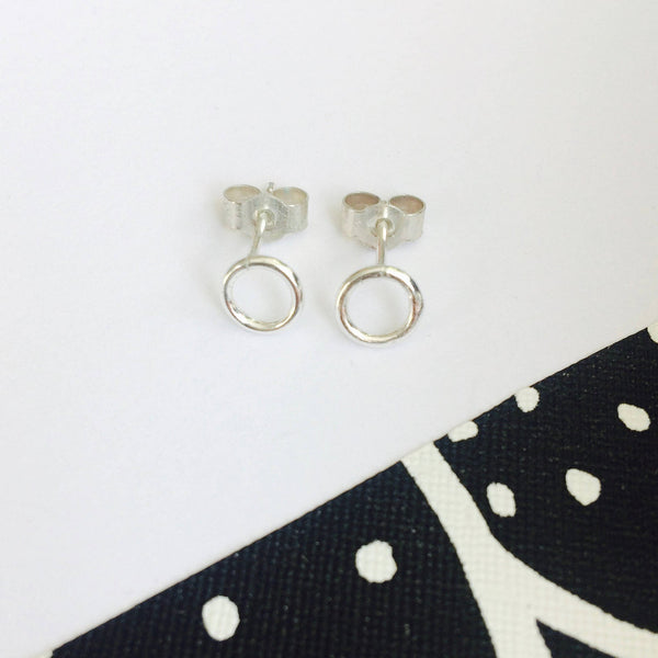 Tiny silver circle studs