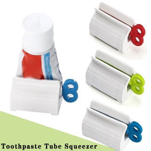 Load image into Gallery viewer, Multifunctional Bathroom Squeezer Toothpaste Dispenser Plastic Squeezing Dispenser Tooth Paste Rolling Tube Squeezer