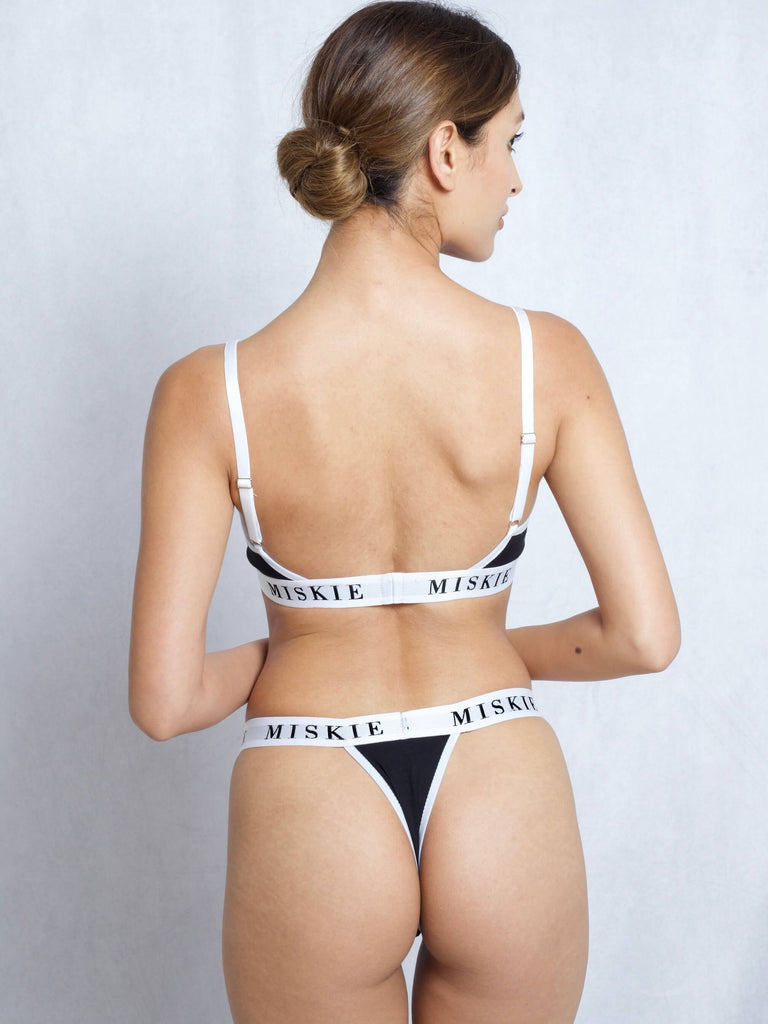 <transcy>Bralette & Tanga Set In Schwarz</transcy>