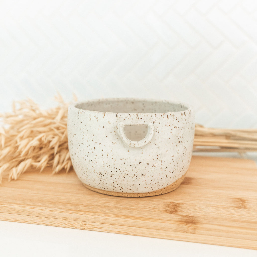 Handmade ceramic matcha bowl with pouring spout.