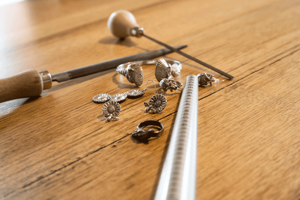 Jewellery scattered with tools on bench