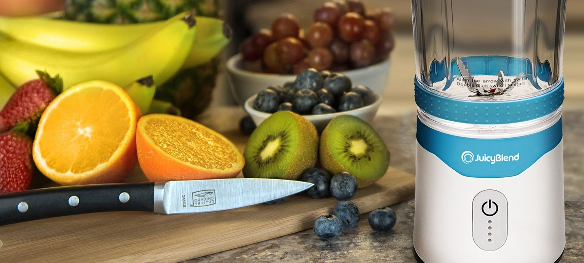 Lifestyle image for light blue JuicyBlend portable blender with cutting board, fruit and knife as background.