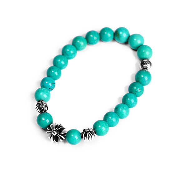 TURQUOISE BEAD BRACELET 8MM (4 SILVER BEADS)
