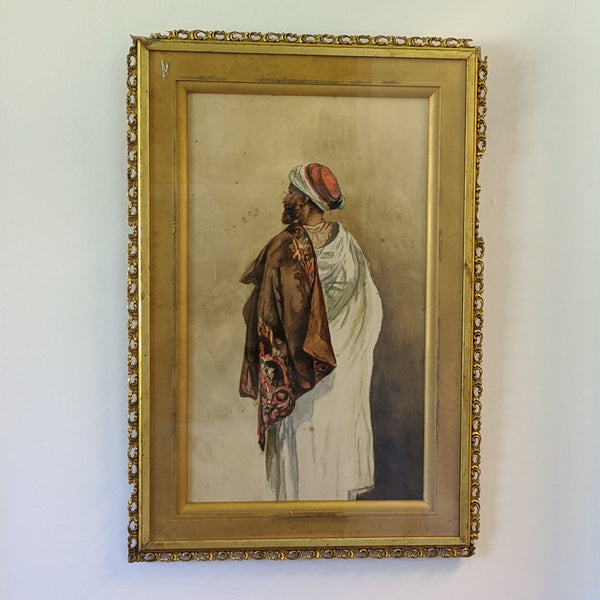 Water color painting of Arabic man with his back towards viewer. Framed.
