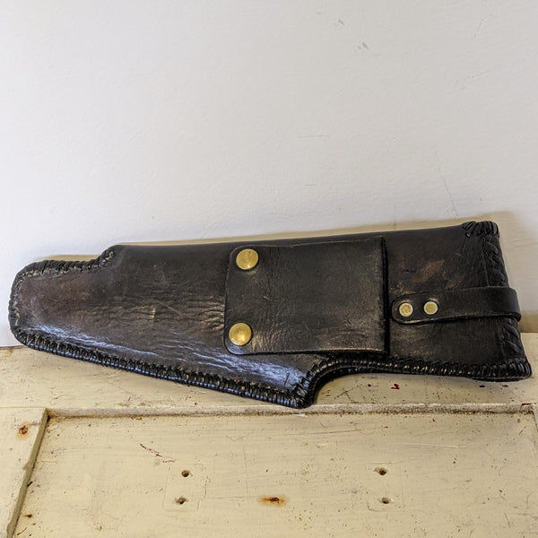 leather gun holster back. Snaps for belt attachment