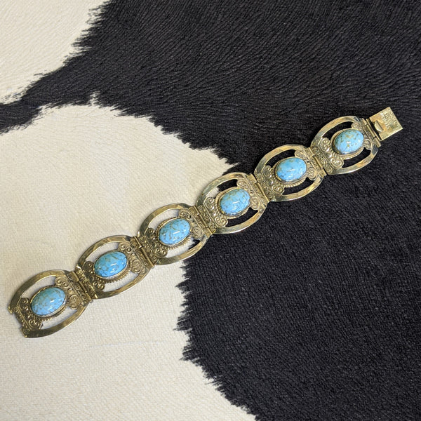 Silver and turquoise western-style bracelet laid flat