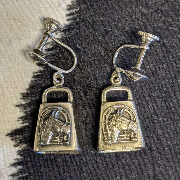 Close up of horses on cowbell earrings
