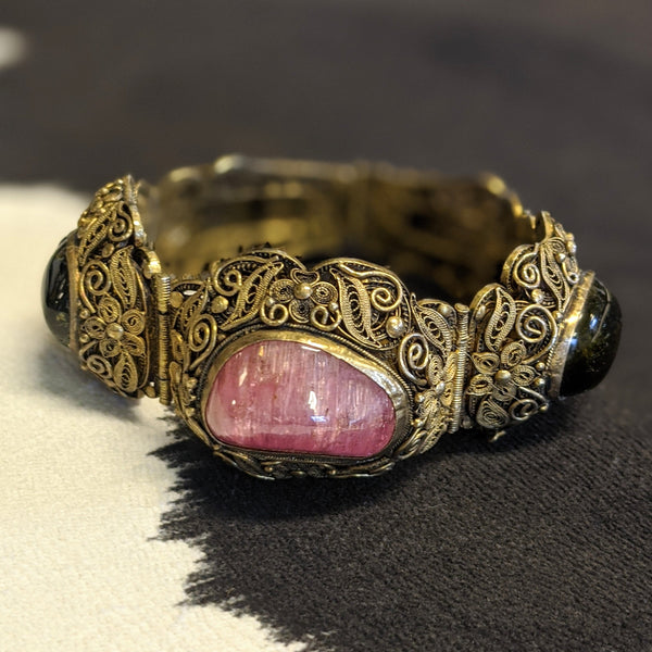 antique scroll bracelet close up on pink stone