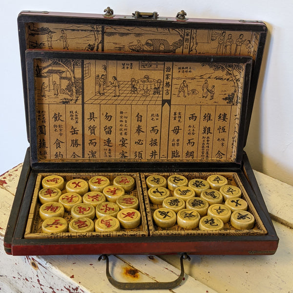 carrying case open showing checker pieces
