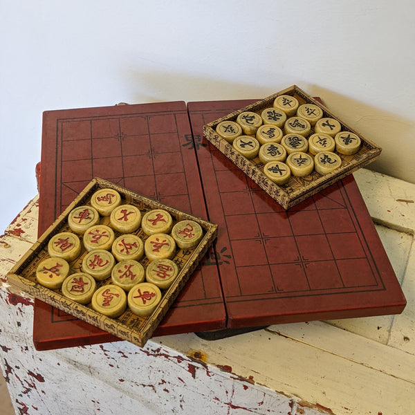 Checkers game flat with checkers pieces on top in square holders
