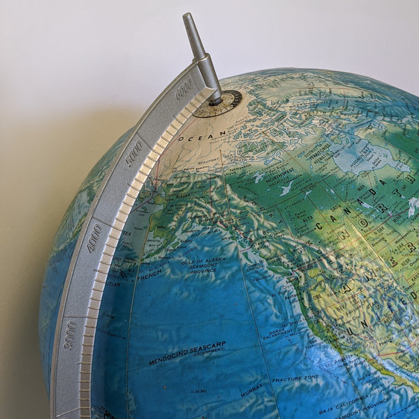 Close-up of top of globe and stand