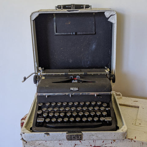 Vintage, black typewriter with round letter buttons
