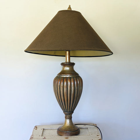 Bronze color art deco lamp with big, brown lamp shade