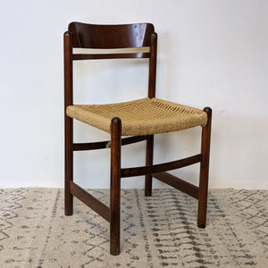 Dark wood chair with woven wicker seat