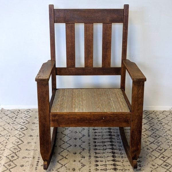 Dark wood antique mission rocking chair front view
