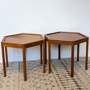Short, hexagon tables side-by-side