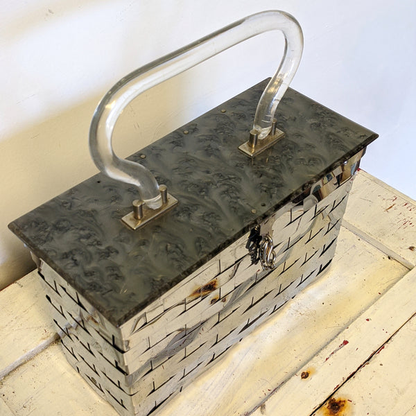 Metal basket weave purse with Lucite handle top view