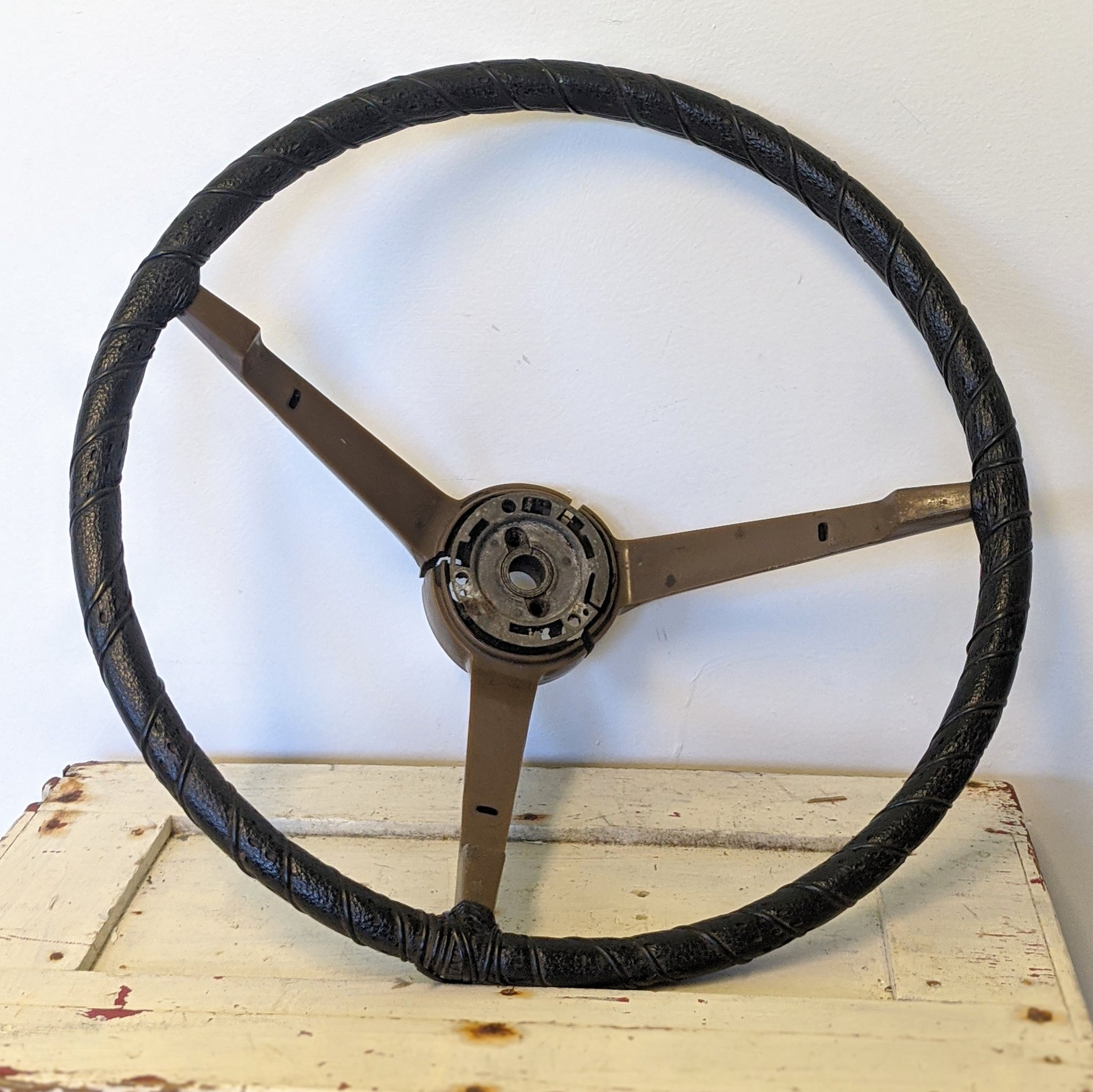 Black and brown vintage hot rod car wheel