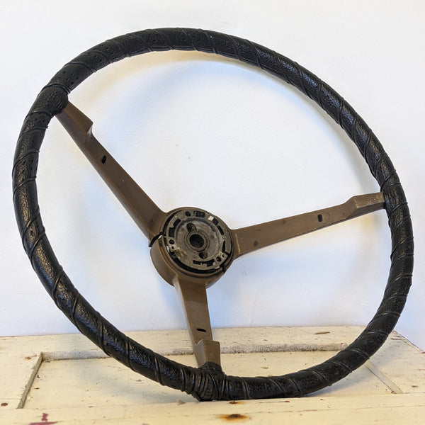 Black and brown vintage hot rod car wheel side