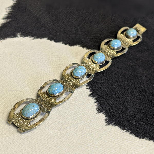 Silver and turquoise western-style bracelet close up