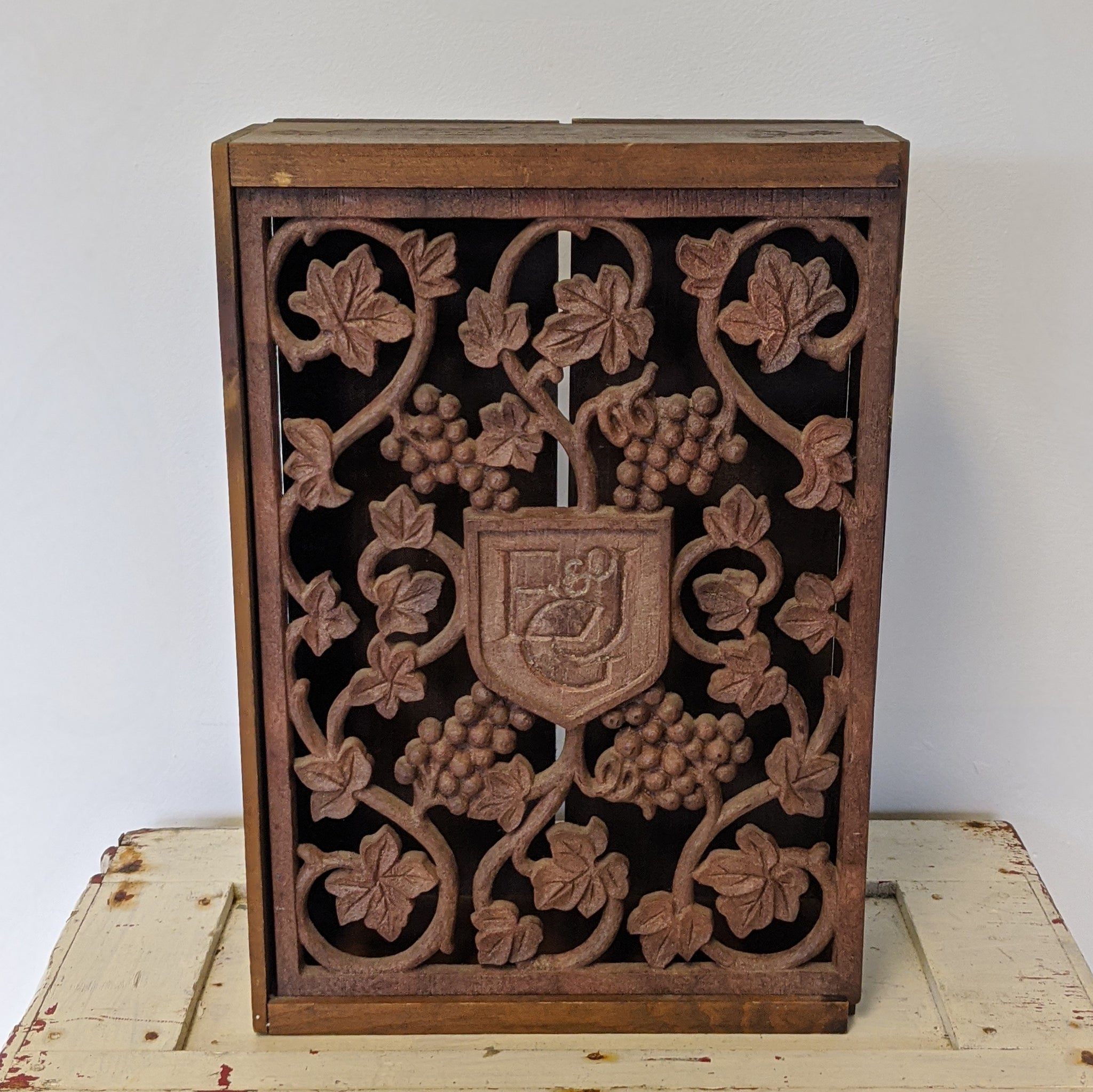 Wooden box with grapevines and E&JG Logo at center