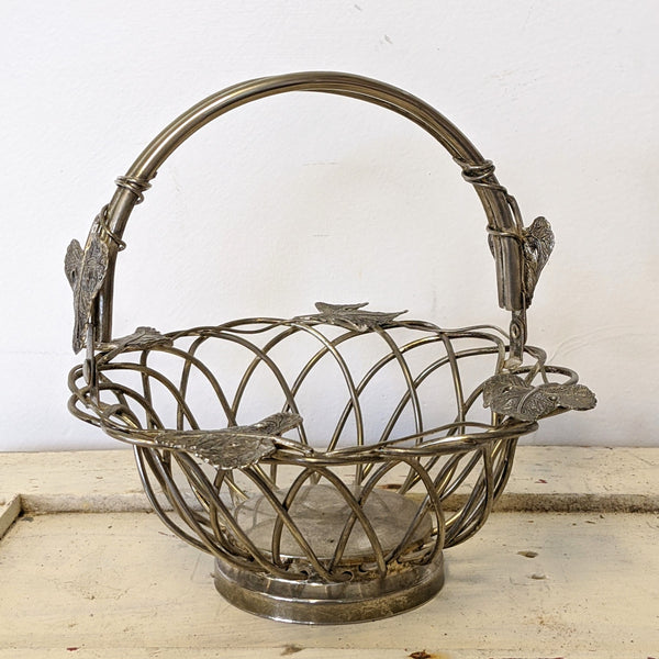 Vintage metal basket with leaves side