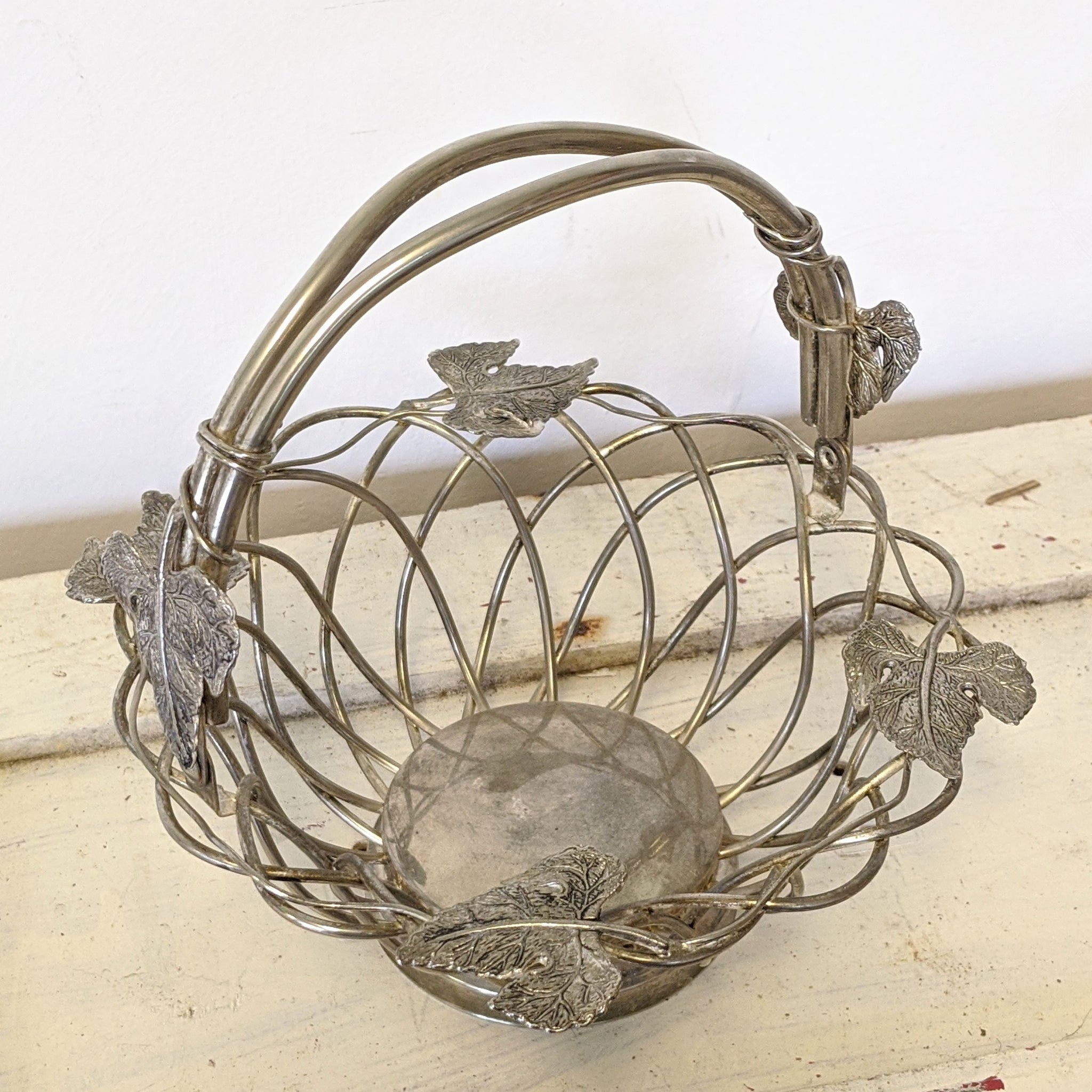 Vintage metal basket with leaves