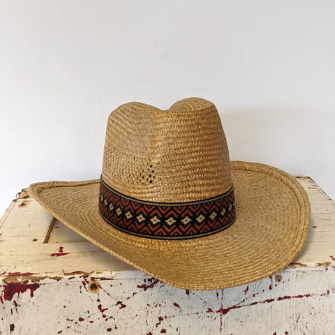 Western straw hat with black and orange band