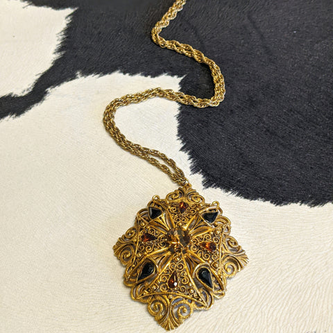 Gold necklace with black brown and gold stones