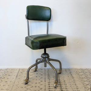 Green industrial chair on wheels