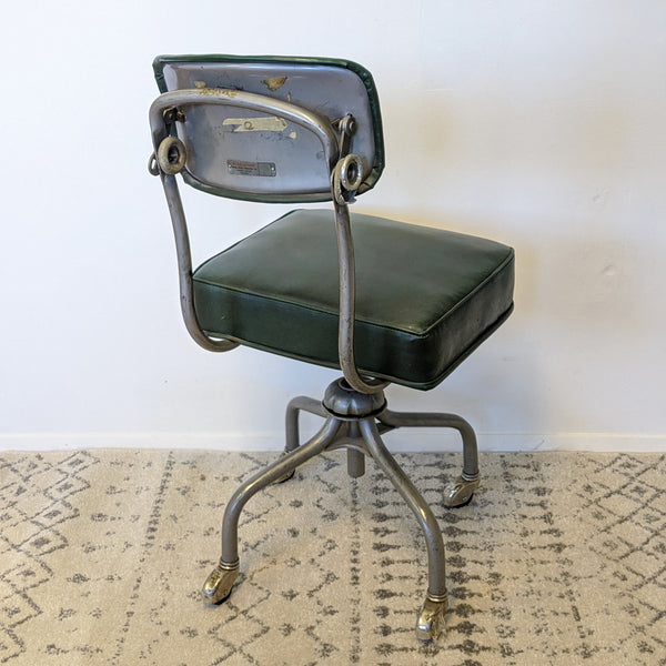 Back of green industrial chair