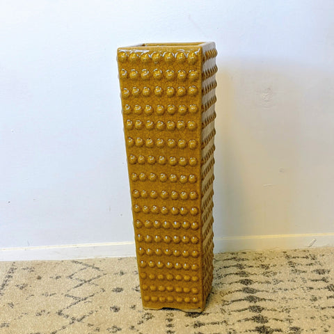 Tall mustard colored vase with 3d dot pattern