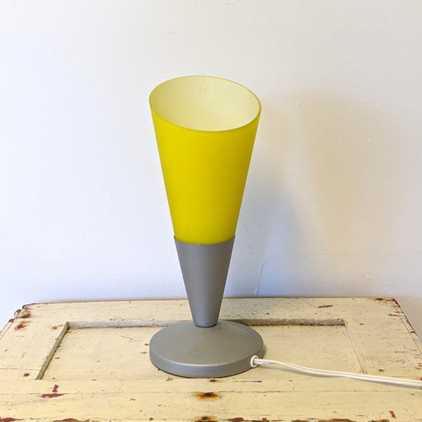 Front of yellow lamp with grey bottom