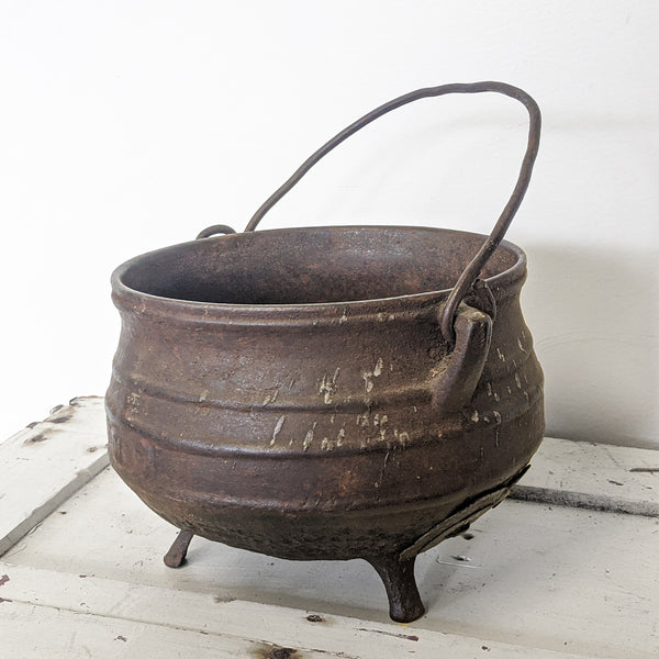 Brown witch's pot with handle side view