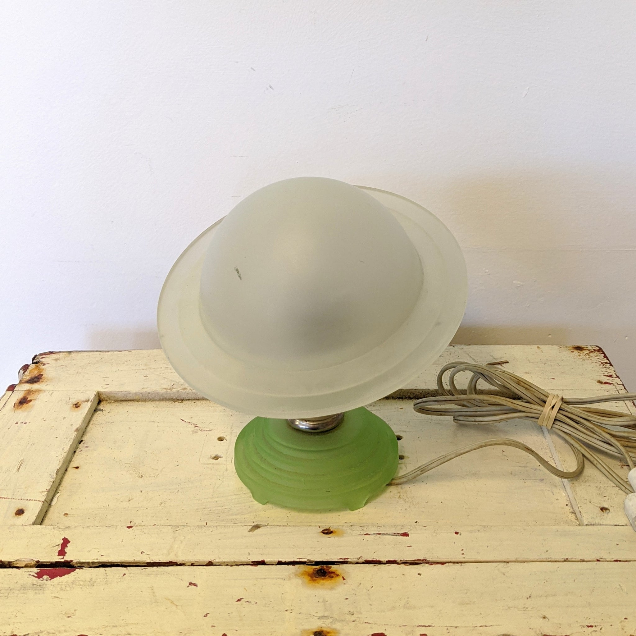 White frosted glass lamp in shape of Saturn with green frosted glass bottom