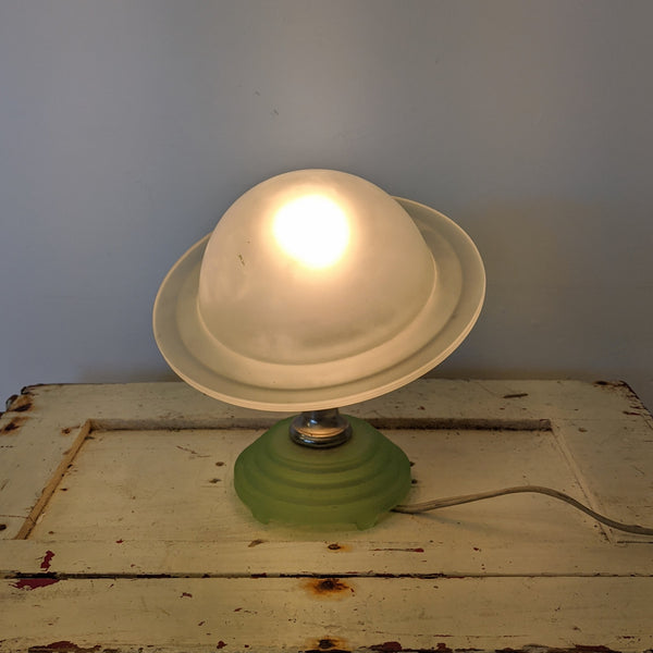 Saturn glass lamp turned on