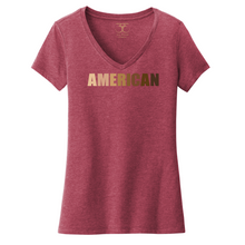 "Load image into Gallery viewer, Heathered cardinal red women's v-neck cotton/poly short sleeve graphic t-shirt with ""American"" printed in a gradient of skin tones."