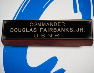 1942-6. Unique wooden desk plaque with name and rank of Hollywood Legend and Decorated War Hero Douglas Fairbanks, Jr.
