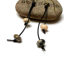 Load image into Gallery viewer, KNOTTED LEATHER TASSEL EARRINGS. PEBBLE GLASS. EARTHY.