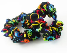Load image into Gallery viewer, handmade science STEM scrunchie with plantes, gears, flasks, circuits, biology, and physics designs