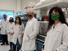 Load image into Gallery viewer, handmade science theme face masks being worn by laboratory scientists in a science lab
