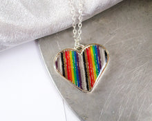 Load image into Gallery viewer, rainbow ribbon cable made into a heart necklace with resin