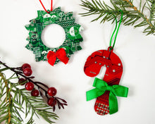 Load image into Gallery viewer, red candy cane and green wreath ornament made from recycled circuit boards