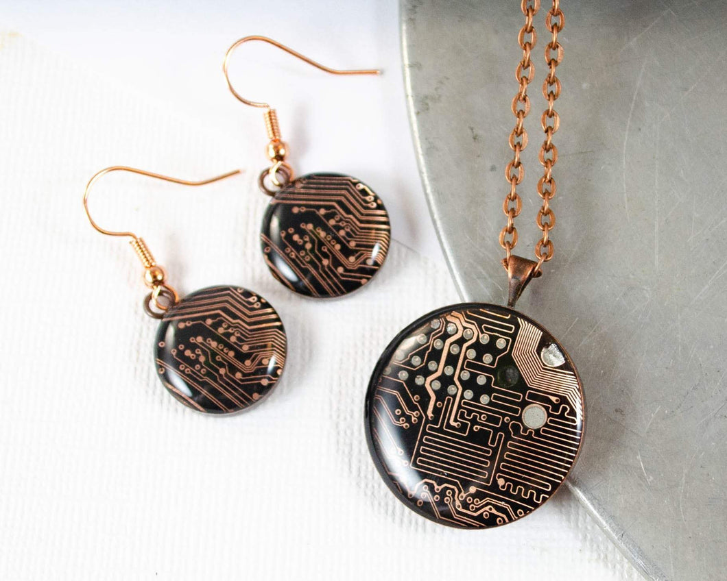 handmade necklace and earrings set made from recycled circuit board and set in copper