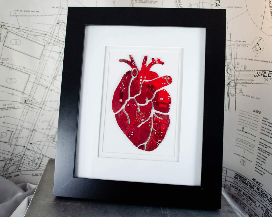 large art piece of anatomical heart made from recycled circuit boards