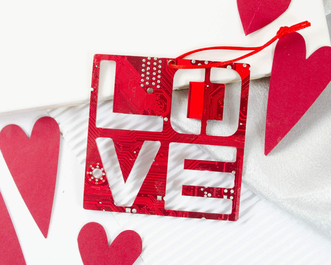 handmade love ornament made from red circuit board